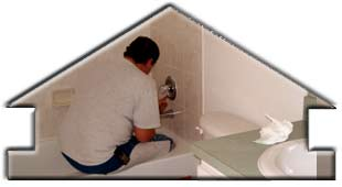 Click for larger image of Steve putting final touches on bathroom grouting on new home